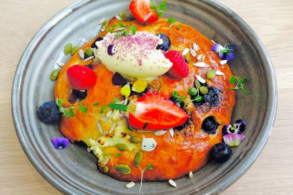 Hot cake with house made ricotta, blueberries, pure maple, double cream, nuts and seeds