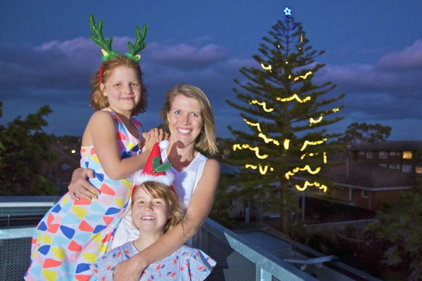 Cath White and her daughters Samantha (left) and Olivia (right).     [Photo by James O'Sullivan]